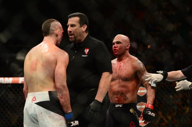 Jul 11, 2015; Las Vegas, NV, USA; Robbie Lawler (red gloves) and Rory MacDonald (blue gloves) fight during their welterweight title bout during UFC 189 at MGM Grand Garden Arena. Lawler won via fifth round TKO. Mandatory Credit: Joe Camporeale-USA TODAY Sports