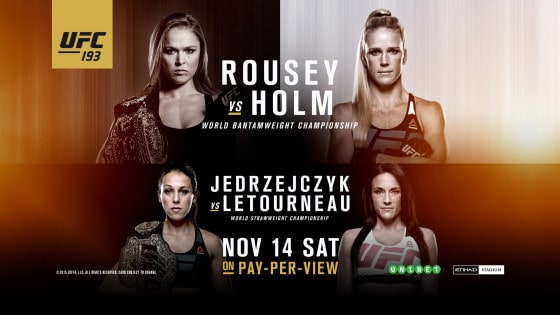 193-rousey-holm-banner